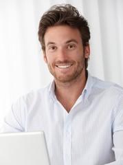 Office portrait of happy businessman