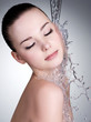 Water falling on the beautiful face of woman