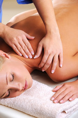 Woman having massage in spa salon