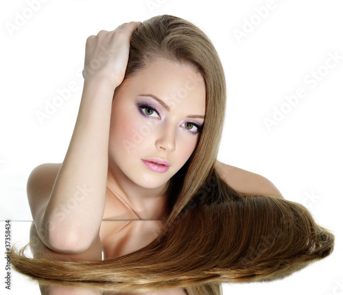 Portrait of beautiful young woman with long straight hair