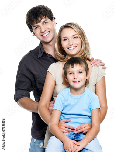 Happy young family with  child - isolated