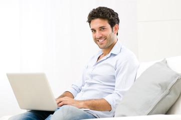 Relaxing at laptop