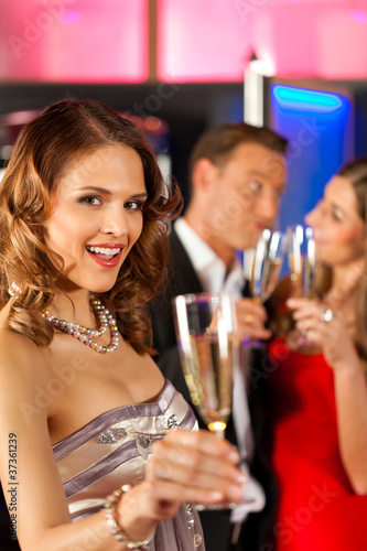 People with champagne in a bar