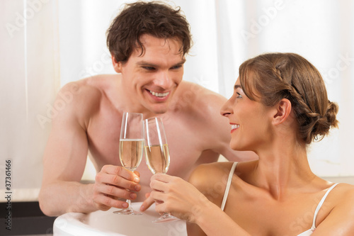 Couple is doing wellness with champagne