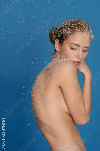 Naked woman in snow