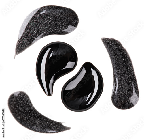 Black and silver nail polish (enamel) drops sample, isolated on
