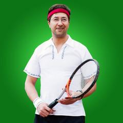 Mature man playing tennis studio portrait