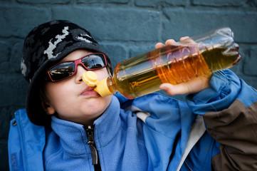 cool boy is drinking softdrink