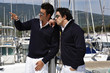 Italy, Tuscany, sailors dressed casual on a sailing boat