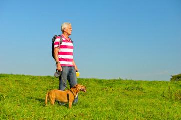 Hiking man with dog