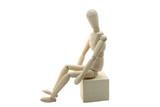Wooden Manikin Doll Sitting On Box poster