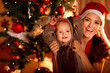 Portrait of mother and baby in suit of Santa's little helper