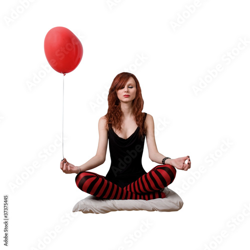 Portrait of red caucasian girl with heart balloon.