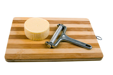 Round cheese on a wooden board