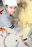 Man padding walls with insulation