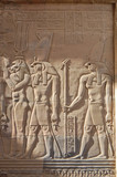 Egyptian engraved gods image on wall in Kom Ombo temple, Egypt