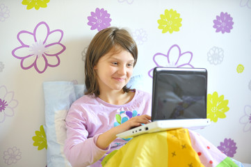 girl with laptop in her bed