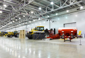 tractors are in room at exhibition, special agricultural machine