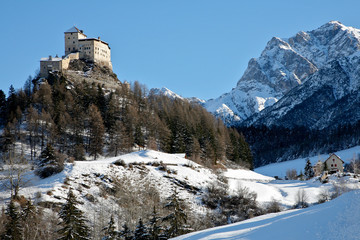 Tarasp Switzerland mountains in the summer and a castle