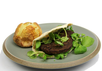 Vegetarian burger in Pitta bread with Baked Potato