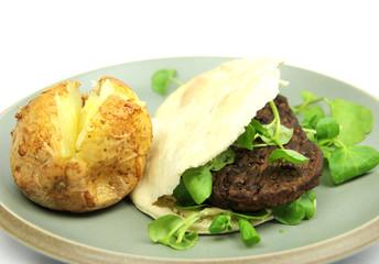 Plain Baked Potato, a vegetarian burger in Pitta bread