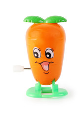 funny toy clockwork orange carrot with face on white