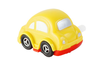 bright toy clockwork yellow automobile with silver windows