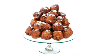 dutch traditional oliebollen on glass-plate