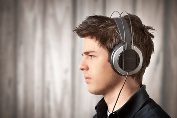 Young man who listens to music