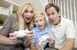 Family Having Fun Playing Video Console Game