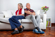 Couple Sitting on Sofa After Quarrel