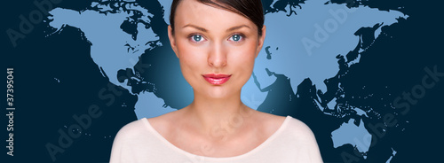 Portrait of young pretty woman looking at camera with map on bac
