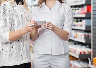 Female Pharmacist Advising Customer