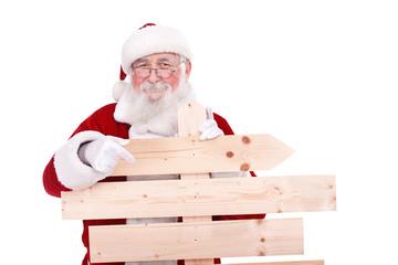 Santa Claus pointing wooden sing
