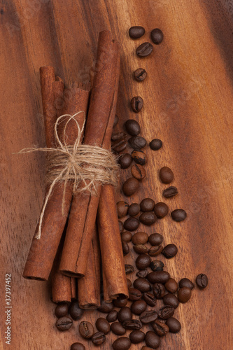 cinnamon and coffee beans over wooden table