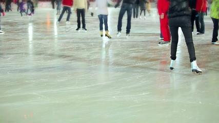 Headless people skating in skating rink