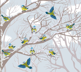 Flock of blue tits perching on branches of trees