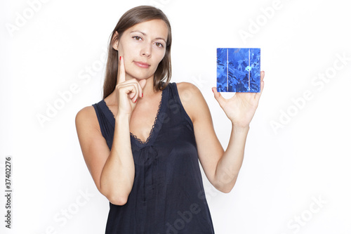 Pretty woman shows a solar cell