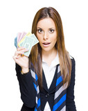 Surprised Young Business Woman Holding Fan Of Money