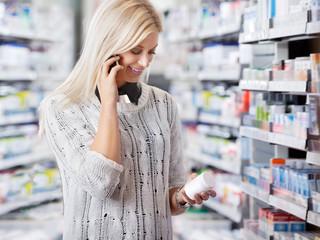 Woman in Pharmacy Talking on Phone