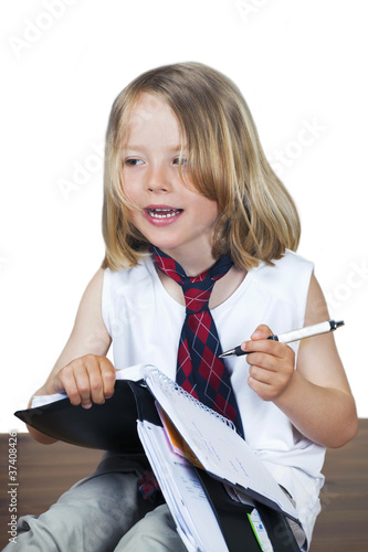 Cute child with business look, acting like dad