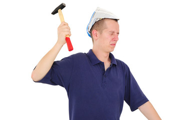 Young worker nailing with hammer