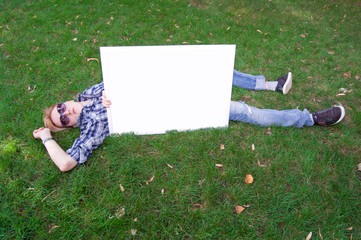 Young human on the green grass with white frame