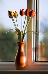Wooden tulips by window
