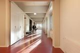 modern public school, corridor red floor poster
