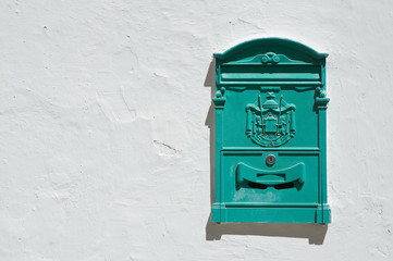 Green postbox.