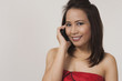 Smiling asian woman on cell phone