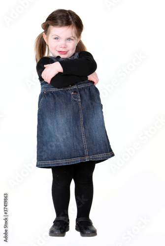Sassy toddler girl with arms folded