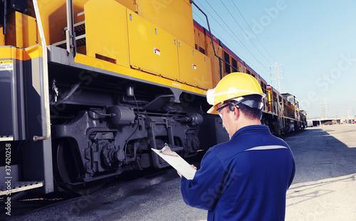 worker checking train engine - 37420258