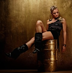 Attractive steam punk girl on a barrel